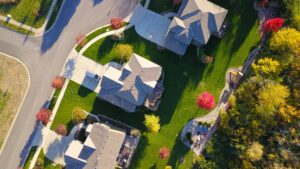 birds eye view of three houses