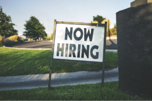 white-and-black-now-hiring-signage
