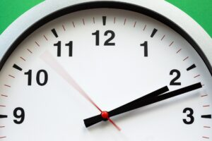 white clock time moving