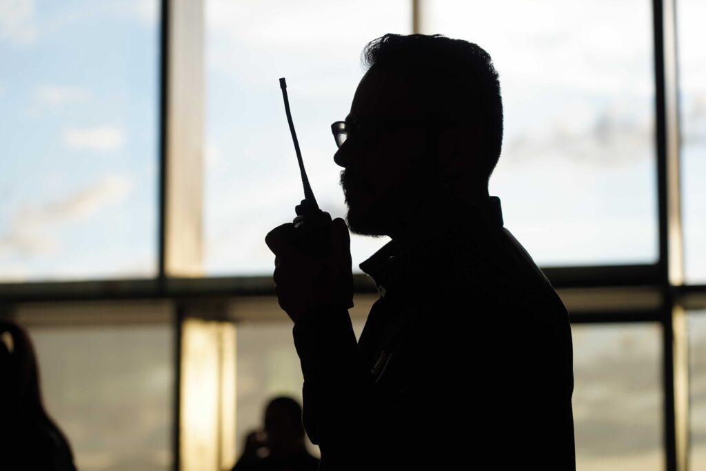 man on walkie talkie inspecting