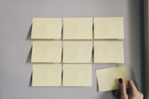sticky notes and hand