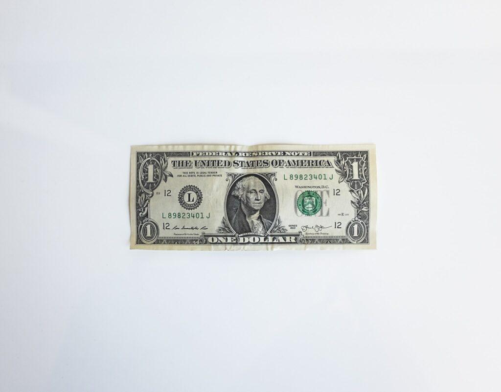1 dollar cash money on white background