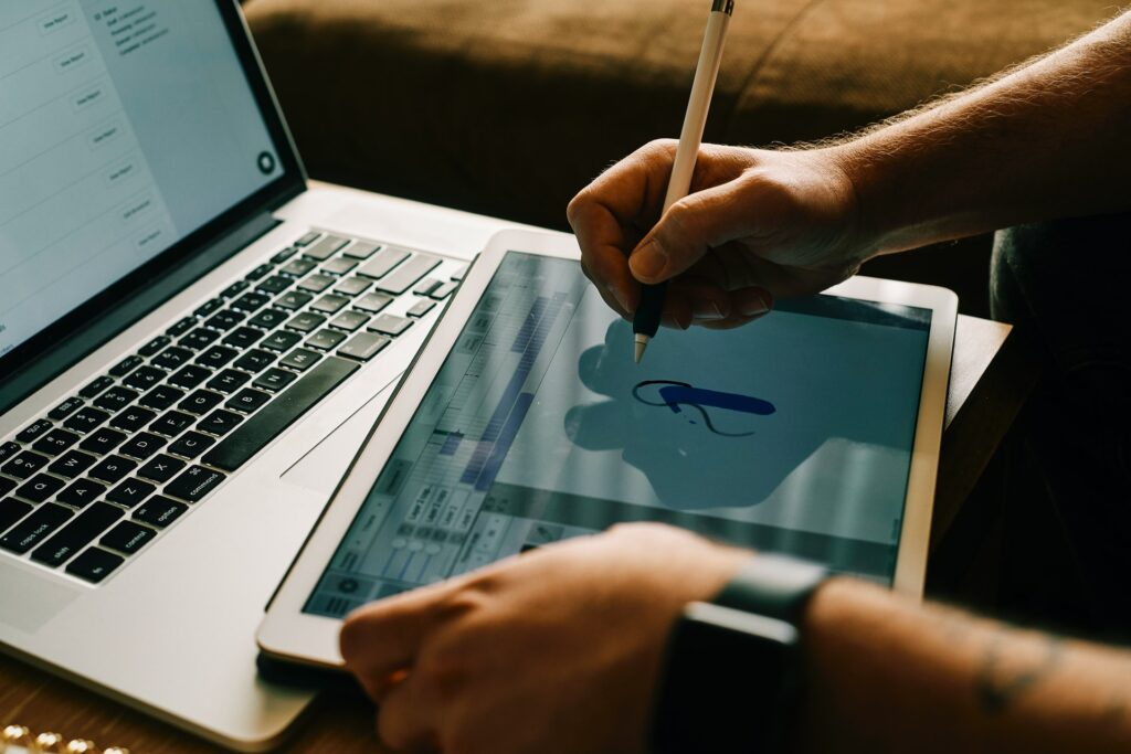 drawing on tablet computer hand