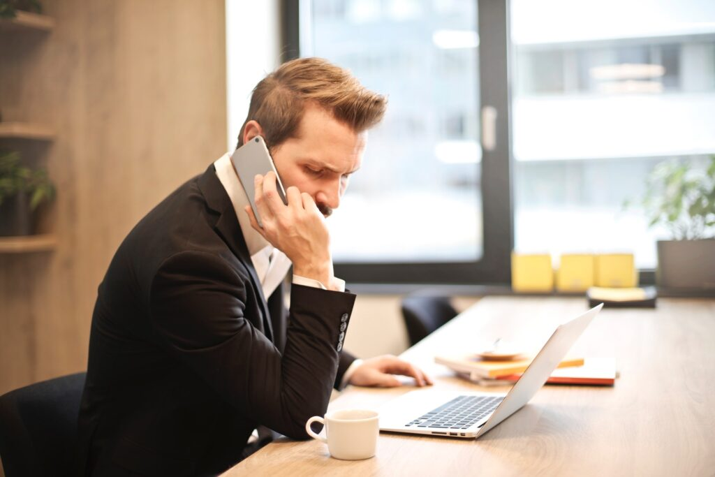 man having a phone call in office
