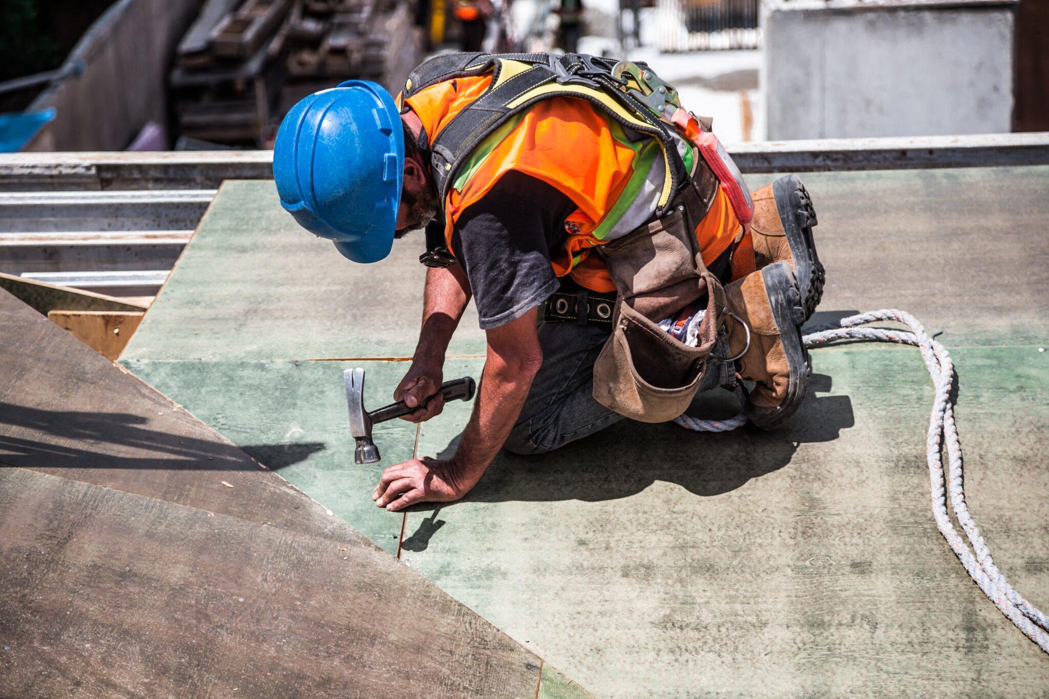 man wearing blue hat construction