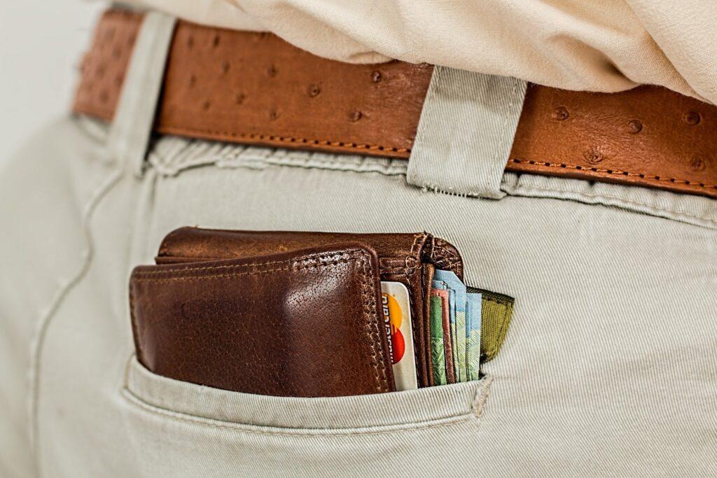 money in back pocket in wallet credit cards cash