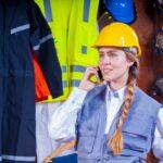 woman in gray vest construction worker inspector