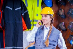 woman in gray vest construction worker inspector