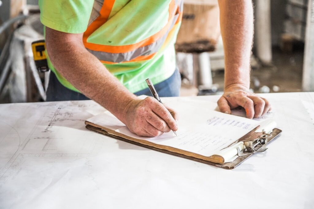 contractor filling out paperwork